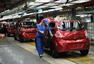 This file photo shows workers assembling a car at Chinese carmaker&#39;s Chery Automobile plant in Wuhu, east China&#39;s Anhui province, in 2011. Some 23,000 cheap Chinese-made cars, including Chery, were on Wednesday recalled in Australia after asbestos was found in their engines, with unions demanding to know how they came to be in the country