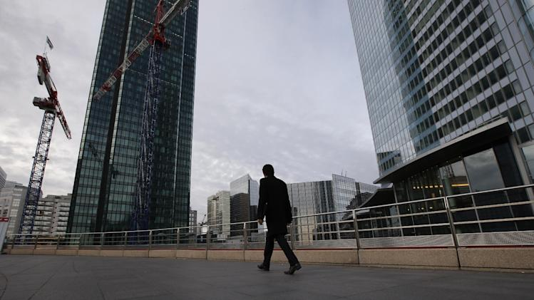 A man walks in the business district of La Defense in Paris, Tuesday, Nov. 20, 2012. In a setback for President Francois Hollande's Socialist government, Moody's Investors Service stripped Europe's No. 2 economy of it of its prized AAA credit rating late Monday on concerns that its rigid labor market and exposure to Europe's financial crisis were threatening its prospects for economic growth. (AP Photo/Francois Mori)