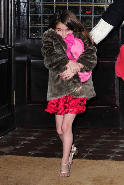 What would a gallery of maturely-dressed children be without a photo of six-year-old Suri Cruise in a scarlet laser-cut silk mini dress with a fur evening coat and metallic gold heels? It would be a h