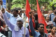 Trade union members and demonstrators shout slogans against Maruti Suzuki and the Haryana state government during a protest in New Delhi on July 20. India's top carmaker Maruti Suzuki has said it was locking out workers at one of its plants hit by a riot in which one manager burned to death and nearly 100 other executives were injured