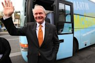 Sinn Fein presidential candidate Martin McGuinness canvasses in Dublin in October 2011. Queen Elizabeth II made a historic gesture in Northern Ireland's peace process when she shook hands with McGuinness -- a former IRA commander