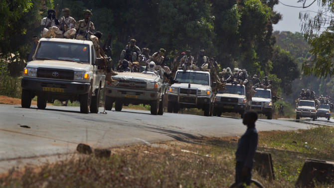 "A convoy of Chadian soldiers who are fighting in support of Central African Republic president Francois Bozize, moves along the road in Damara, about 70km (44 miles) north of the capital Bangui, Central African Republic Wednesday, Jan. 2, 2013. More than 30 truckloads of troops from Chad line the two-lane highway just outside of Damara, supporting government forces who want to block a new rebel coalition from reaching the capital, and Gen. Jean Felix Akaga, who heads a 10-nation regional force, says the town is a ""red line that the rebels cannot cross"" or his forces will attack. (AP Photo/Ben Curtis)"
