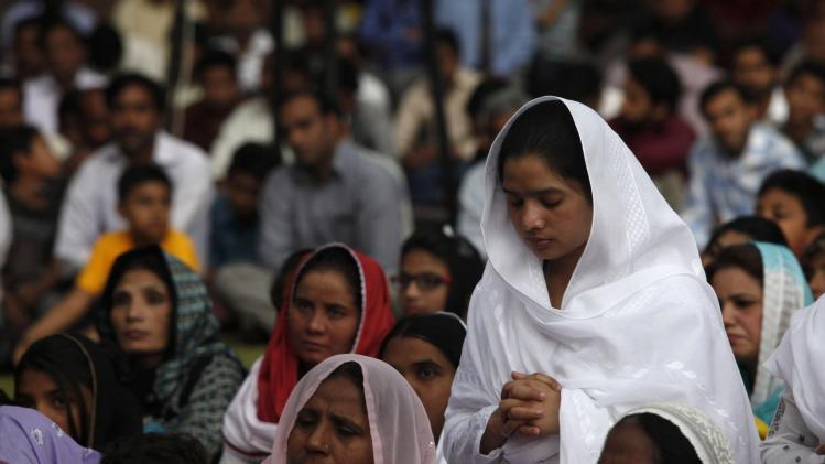 A Pakistani Christian woman attends a Good Friday service with others at the Saint Anthony Church in Lahore