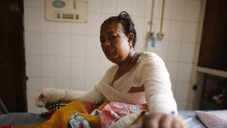 Jahanara, a street hawker, sits on a bed at the Dhaka Medical College Hospital