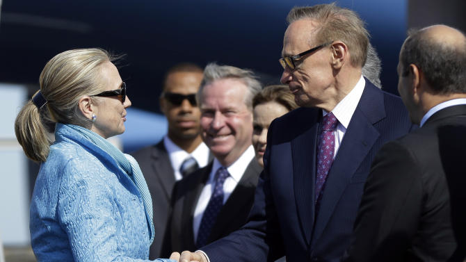 U.S. Secretary of State Hillary Rodham Clinton shakes hands with Australian Foreign Minister Bob Carr, right, upon her arrival at Perth International Airport, Tuesday, Nov. 13, 2012, in Perth, Australia. (AP Photo/Matt Rourke, Pool)