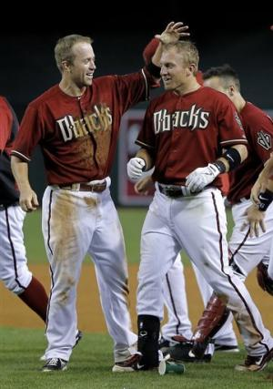 Pennington lifts D'backs over Cards in 16 innings