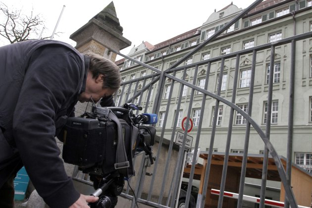 A cameraman films the police headquarters in Munich, southern Germany, Sunday, Feb. 19, 2012. Munich police detained British heavyweight boxer Dereck Chisora following his brawl with former WBA champi