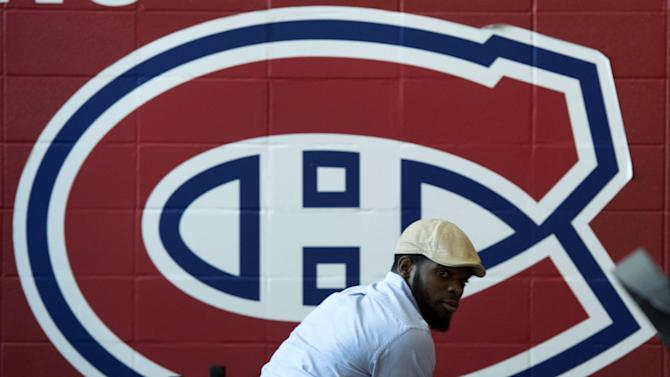 Montreal Canadiens' P.K. Subban looks back as he signs souvenirs at the team's training facility Saturday, May 31, 2014 in Brossard, Quebec. The Canadiens were eliminated from the NHL hockey Stanley Cup playoffs by the New York Rangers in Game 6 of the Eastern Conference final on Thursday, May 29