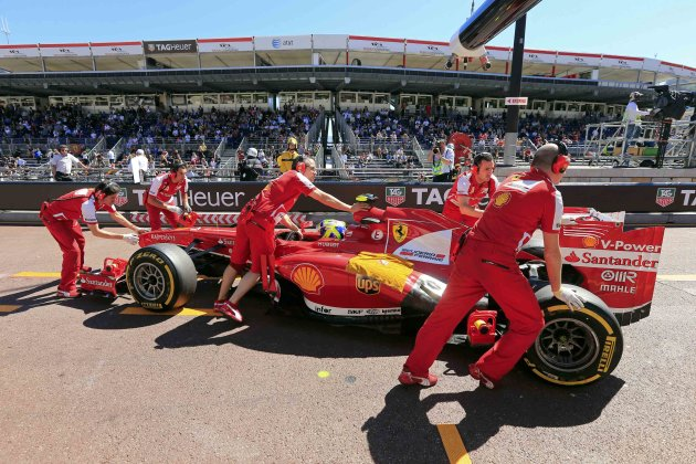 Ferrari Formula One driver Felipe Massa of Brazil is pushed in the pit area during the first practice session of the Monaco F1 Grand Prix