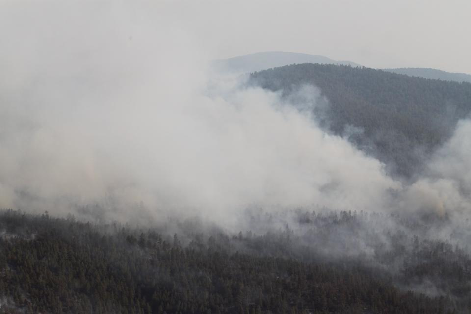 Smoke from the Whitewater-Baldy fire rolls over ridges in the Gila Wilderness near Reserve, N.M., on Thursday, May 31, 2012. The blaze has charred more than 190,000 acres to become the largest wildfire in New Mexico's recorded history. (AP Photo/Susan Montoya Bryan)