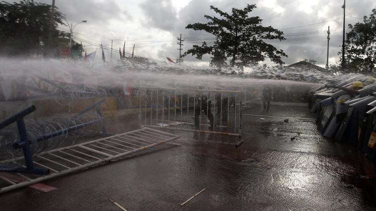 Police disperse protesters with water cannons in Quezon city