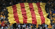 "<p>A giant Catalan flag is displayed by supporters of Artur Mas, leader of Spain's Catalonia region, during a final meeting for his re-election campaign. Mas vowed Friday to fight for the ""future of our nation"" before a roaring crowd of supporters, ahead of weekend elections that could lead to a popular demand for statehood.</p>"