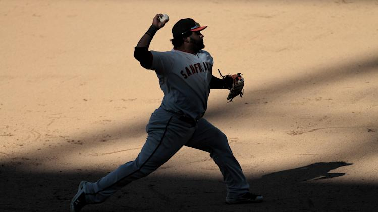 San Francisco Giants third baseman Pablo Sandoval (48) throws out Colorado Rockie' Jordan Pacheco during the ninth inning of a baseball game Sunday, Sept. 18, 2011 in Denver. The Giants won 12-5.  (AP Photo/Barry Gutierrez)