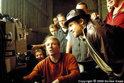 Director Guy Ritchie , Brad Pitt and crew watch the playback monitors during the filming of Snatch (2001) from Screen Gems.