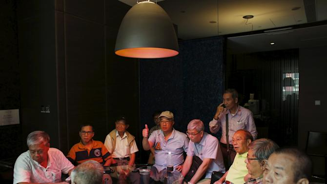 Members of the Hong Kong Reparation Association hold a meeting in Hong Kong, before holding a protest march to the Japanese consulate and Bank of Tokyo-Mitsubishi later in the month