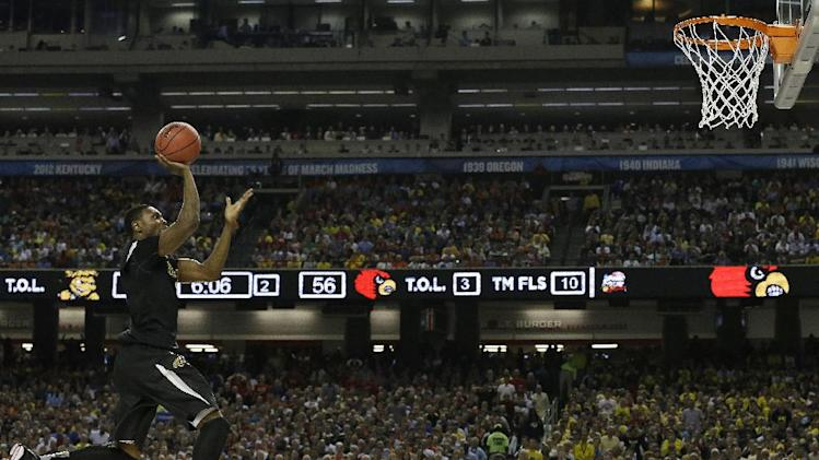 Wichita State's Cleanthony Early (11) heads to the hoop against Louisville during the second half of the NCAA Final Four tournament college basketball semifinal game Saturday, April 6, 2013, in Atlanta. (AP Photo/Charlie Neibergall)