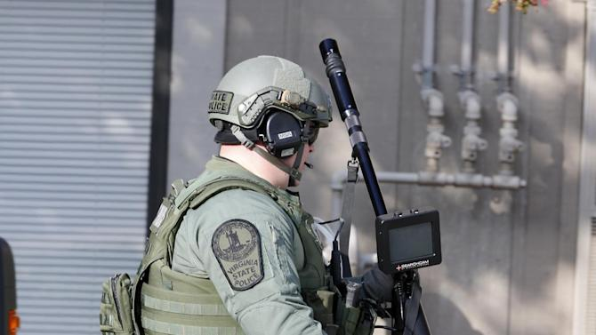 A State Police officer brings equipment to the apartment of Vester Lee Flanagan II, in Roanoke, Va., Wednesday, Aug. 26, 2015.  Flanagan filmed himself gunning down a WDBJ-TV reporter and cameraman during a live television interview Wednesday and posted the video on social media after fleeing the scene.  (AP Photo/Steve Helber)