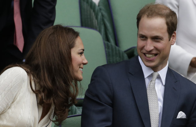 Britain's Prince William, right, and Kate, Duchess of Cambridge watch Roger Federer of Switzerland play Mikhail Youzhny of Russia during a quarterfinals match at the All England Lawn Tennis Championsh