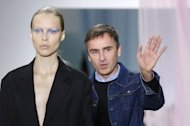 Belgian designer Raf Simons for Christian Dior acknowledges the public at the end of his Spring/Summer 2013 ready-to-wear collection show on September 28, 2012 in Paris
