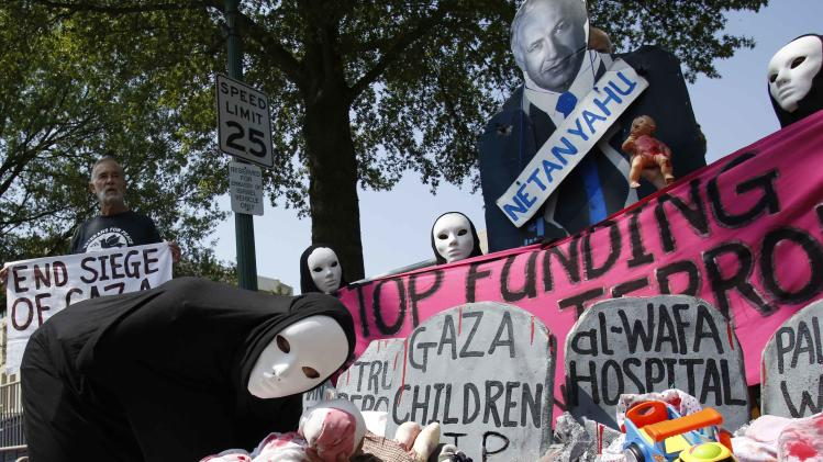 Codepink activists, dressed to symbolize those wounded and killed in Gaza, rally outside the Israeli Embassy in Washington