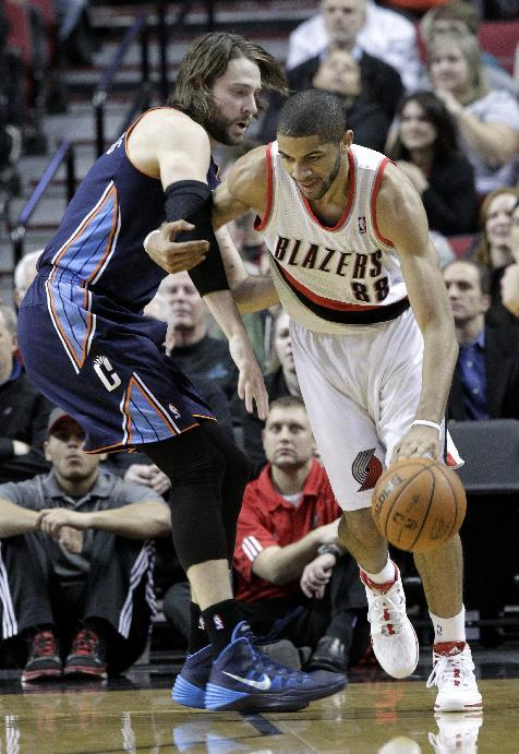 Portland Trail Blazers forward Nicolas Batum, right, from France, drives on Charlotte Bobcats forward Josh McRoberts  during the first half of an NBA basketball game in Portland, Ore., Thursday, Jan.