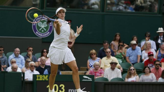 Christina McHale of the U.S.A. hits a shot during her match against Sabine Lisicki of Germany at the Wimbledon Tennis Championships in London