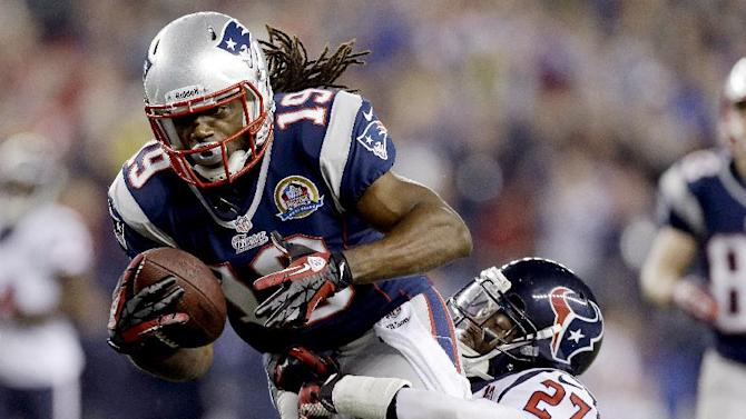 FILE - In this Dec. 10, 2012, file photo, New England Patriots wide receiver Donte' Stallworth (19) dives into the end zone for a touchdown while dragging Houston Texans defensive back Quintin Demps, right, during the third quarter of an NFL football game in Foxborough, Mass. Stallworth, a free agent, was hospitalized Saturday, March 16, 2013, with serious burns after the hot air balloon carrying him and two other people crashed into power lines above South Florida, his agent, Drew Rosenhaus, said. (AP Photo/Elise Amendola, File)