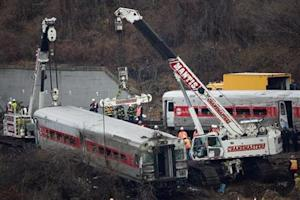 The lead car in the Metro-North train derailment is pulled from the marsh in the Bronx borough of New York