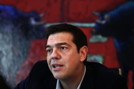 Greece's leftist main opposition Syriza party leader Alexis Tsipras speaks during an interview with Reuters in Athens