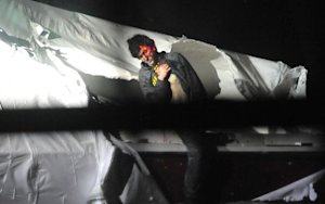 New Photos Show the Moment Dzhokhar Tsarnaev Was Captured by Police