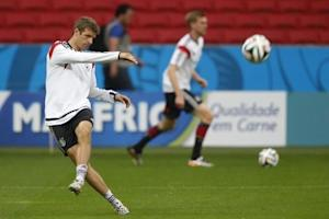 Germany's national soccer player Mueller kicks for the ball during a training session at Beira Rio stadium in Porto Alegre