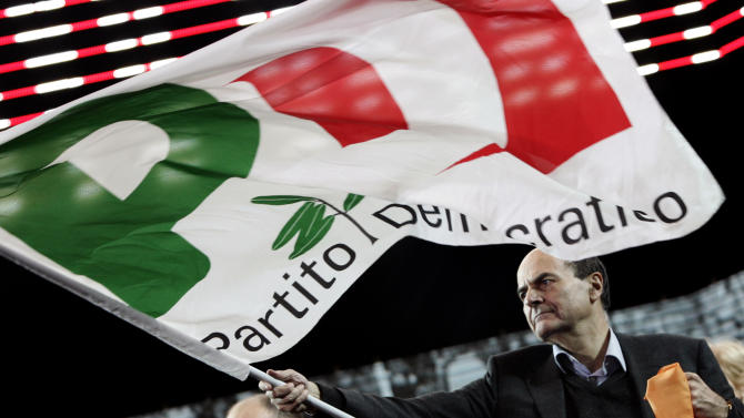 FILE -- In this file photo taken on Dec. 11 2010, Italian center-left leader Pierluigi Bersani waves the party flag at the end of his speech during a demonstration in Rome.  The ascent of Bersani _ whose camp in late January enjoyed roughly 33 percent support against some 27 percent for the Berlusconi side _ also has much to do with his ability to draw on the former Communist Party's entrenched network of activists, funding and economic connections, such as business cooperatives.  (AP Photo/Riccardo De Luca)