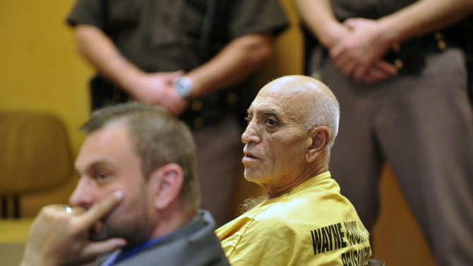 66-year-old defendant Mike Reda, right, and his defense attorney Bryan Sherer sit at the defense table listening to testimony at the Frank Murphy Hall of Justice, Thursday, Oct. 31, 2013 in Detroit. Reda, a 66-year-old great-grandfather told police he was filled with anger and alcohol on the day he shot two women with an assault rifle in a Detroit retirement home, enraged at what he believed was their persistent intrusions into his relationship with another woman, Thursday, Oct. 31, 2013. (AP Photo/Detroit News, John T. Greilick) DETROIT FREE PRESS OUT; HUFFINGTON POST OUT
