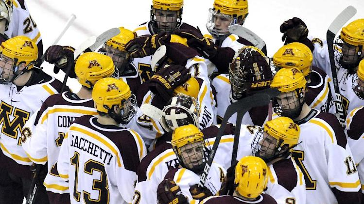 Minnesota players celebrate their 2-1 victory over St. Cloud State in a college hockey game in Minneapolis, Friday, Jan. 27, 2011. (AP Photo/Janet Hostetter)