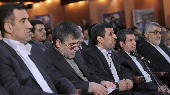 In this photo released by the official website of the office of the Iranian Presidency, President Mahmoud Ahmadinejad, center, speaks in a ceremony commemorating Iran's National Day of Nuclear Technology in Tehran, Iran, Tuesday, April 9, 2013. Iran announced two key nuclear-related projects on Tuesday that expand the country's ability to extract and process uranium, which can be enriched for reactor fuel but also potentially for atomic weapons. Ahmadinejad ordered the symbolic start of operations through a video conference for Iran's National Day of Nuclear Technology, which marks the anniversary of the first time Iran enriched uranium in 2006. The head of Iran's Atomic Energy Organization, Fereidoun Abbasi, sits at second left. (AP Photo/Rouzbeh Jadidoleslam, Presidency Office)