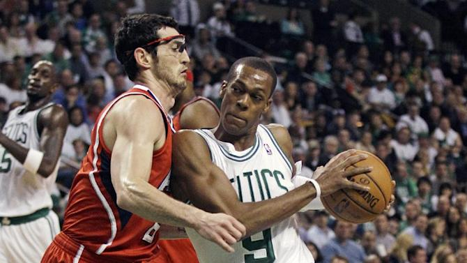 Boston Celtics guard Rajon Rondo (9) drives to the basket against Atlanta Hawks guard Kirk Hinrich (6) during the first quarter of Game 3 of an NBA first-round playoff basketball series, Friday, May 4, 2012, in Boston. (AP Photo/Charles Krupa)