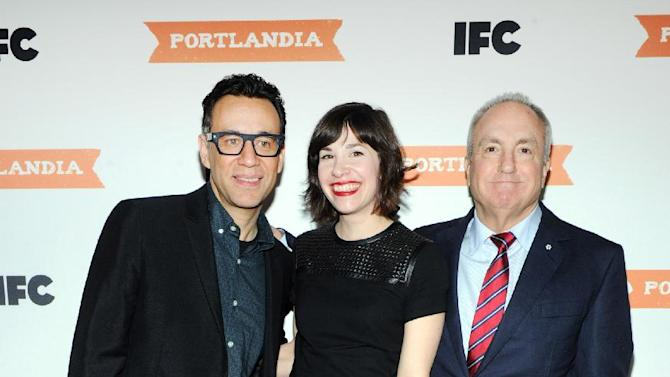 IMAGE DISTRIBUTED FOR IFC - Lorne Michaels, right, executive producer of IFC's Portlandia, joins, Fred Armisen and Carrie Brownstein, co-creators and stars of Portlandia, at the premiere event for Portlandia season 3 at the American Museum of Natural History on Monday, Dec. 10, 2012, in New York. The new season premieres on IFC on Jan. 4 at 10pm ET/PT. (Diane Bondareff/Invision for IFC/AP Images)