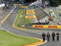 Force India Formula One driver Perez of Mexico walks with his staff on the track ahead of the weekend's Belgian Grand Prix in Spa-Francorchamps