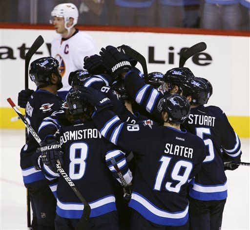 Jets rally to beat Islanders 5-4 in OT