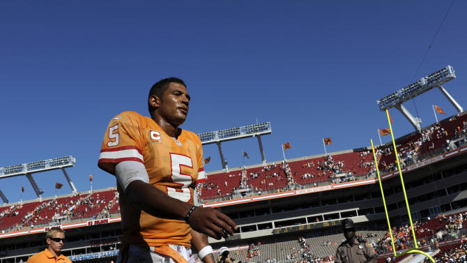 Tampa Bay Buccaneers quarterback Josh Freeman (5) walks off the field following the their 35-28 loss to the New Orleans Saints in an NFL football game, Sunday, Oct. 21, 2012, in Tampa, Fla. (AP Photo/Brian Blanco)