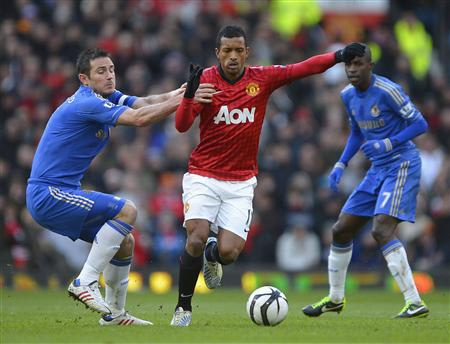 Manchester United's Nani is challenged by Chelsea's Lampard for the ball during their English FA Cup quarter-final soccer match at Old Trafford in Manchester