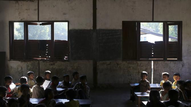 Rohingya children study in a government primary school in Byuhar Kone village, in Maungdaw town in northern Rakhine State