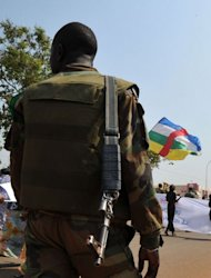 A soldier ensures security during a women's march against the conflict in their country, in Bangui on December 28, 2012. Government soldiers in the Central African Republic battled to re-capture a rebel-held city Friday, a military official said, despite regional efforts to seek a peaceful end to the growing crisis