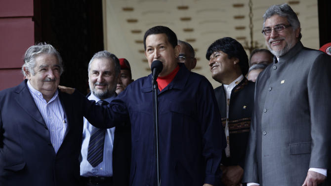Left to right:  Uruguay's President Jose Mujica, Venezuela's President Hugo Chavez, Bolivia's President Evo Morales and Paraguay's President Fernando Lugo stand together during a meeting as a part of Venezuela's Bicentennial celebrations at Miraflores presidential palace in Caracas, Venezuela, Tuesday, July 5, 2011.(AP Photo/Ariana Cubillos)