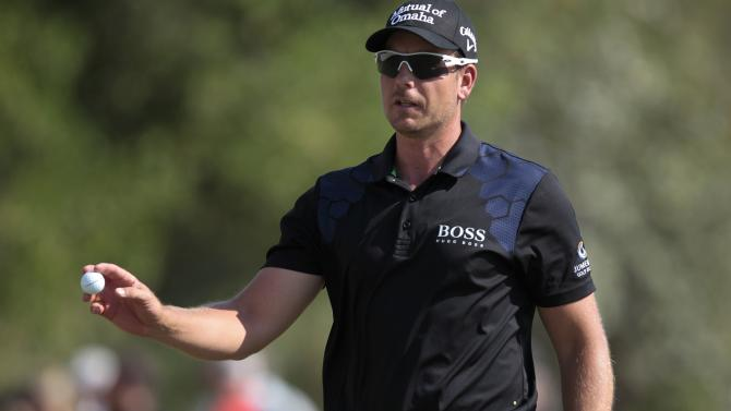 Stenson of Sweden walks on the third green during the final round of the DP World Tour Championship in Dubai