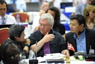 <p>Denmark Commissioners talk during the 64th Annual meeting of the International Whaling Commission in Panama City. Denmark lost a bid to extend whaling by Greenland's indigenous people beyond this year, with EU nations sharing concerns that tourists were being served a glut of whale meat.</p>
