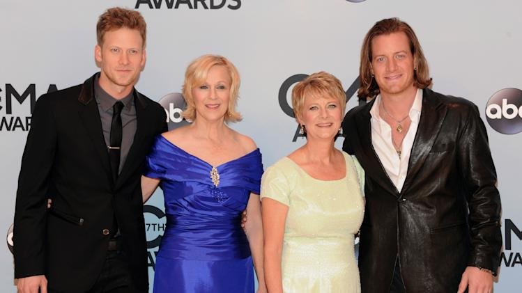 Brian Kelley, left, and Tyler Hubbard, right, of Florida Georgia Line, arrive with their mothers, Mary Margaret, second left, and Amy to the 47th annual CMA Awards at Bridgestone Arena on Wednesday, Nov. 6, 2013, in Nashville, Tenn. (Photo by Evan Agostini/Invision/AP)