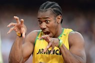 Jamaica's Yohan Blake gestures prior to competing in the men's 200m semi-finals at the athletics event of the London 2012 Olympic Games in London