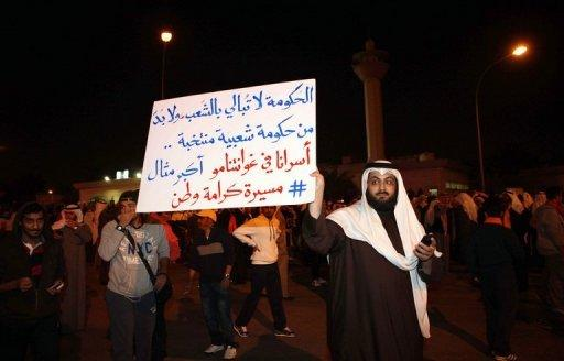 A protestor holds an anti-government placard at a demonstration in Kuwait City on January 6, 2013