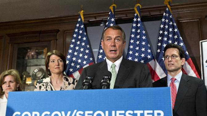 """Following a closed-door party caucus, House Speaker John Boehner of Ohio, accompanied by fellow GOP leaders, meet with reporters, on Capitol Hill in Washington, Tuesday, Feb. 26, 2013, to challenge President Obama and the Senate to avoid the automatic spending cuts set to take effect in four days. Speaking at the Republican National Committee headquarters, Boehner complained that the House, with Republicans in the majority, has twice passed bills that would replace the across-the-board cuts known as the """"sequester"""" with more targeted reductions, while the Senate, controlled by the Democrats, has not acted. From left are, Rep. Lynn Jenkins, R-Kansas, Rep. Cathy McMorris Rodgers, R-Wash., Boehner, and House Majority Leader Eric Cantor of Va.  (AP Photo/J. Scott Applewhite)"""